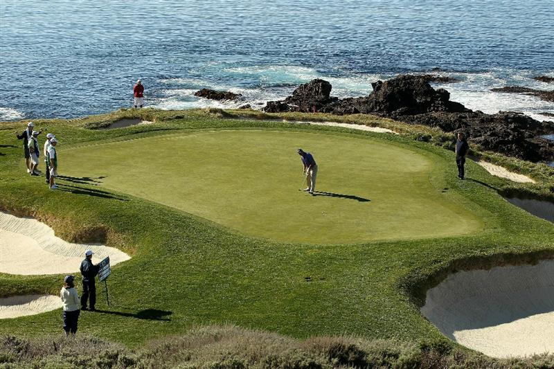 PEBBLE BEACH, CA - FEBRUARY 12:  Chris DiMarco putts on the 7th hole during the third round of the AT&T Pebble Beach National Pro-Am at the Pebble Beach Golf Links on February 12, 2011 in Pebble Beach, California.  (Photo by Ezra Shaw/Getty Images)