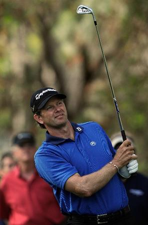 PALM HARBOR, FL - MARCH 22:  Retief Goosen of South Africa plays a shot on the 13th hole during the final round of the Transitions Championship at the Innisbrook Resort and Golf Club on March 22, 2009 in Palm Harbor, Florida.  (Photo by Sam Greenwood/Getty Images)