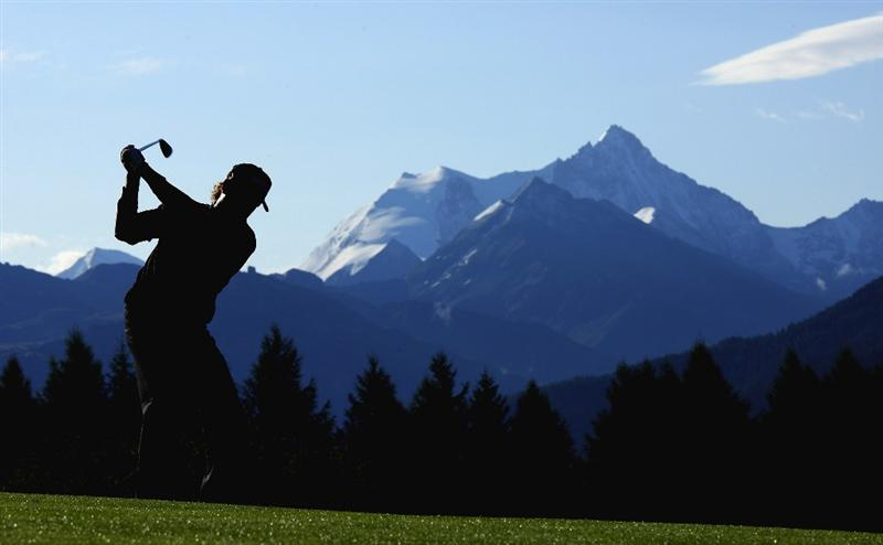 CRANS, SWITZERLAND - SEPTEMBER 05:  Miguel Angel Jimenez of Spain plays his second shot on the 12th hole during the second round of the Omega European Masters at Crans-Sur-Sierre Golf Club on September 5, 2008 in Crans Montana, Switzerland.  (Photo by Andrew Redington/Getty Images)