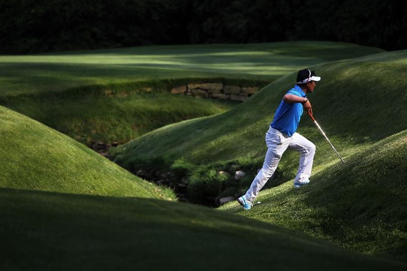 AUGUSTA, GA - APRIL 09:  Y.E. Yang of South Korea walks to the 13th green during the third round of the 2011 Masters Tournament at Augusta National Golf Club on April 9, 2011 in Augusta, Georgia.  (Photo by Jamie Squire/Getty Images)