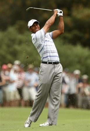 MELBOURNE, AUSTRALIA - NOVEMBER 14:  Tiger Woods of the USA plays an approach shot on the 3rd hole during round three of the 2009 Australian Masters at Kingston Heath Golf Club on November 14, 2009 in Melbourne, Australia.  (Photo by Quinn Rooney/Getty Images)