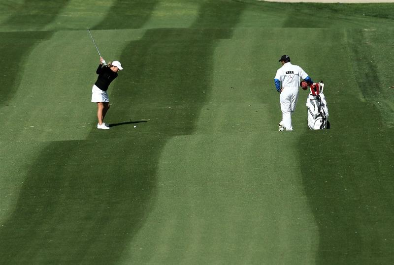 RANCHO MIRAGE, CA - APRIL 01:  Cristie Kerr hits her second shot on the 15th hole during the first round of the Kraft Nabisco Championship at Mission Hills Country Club on April 1, 2010 in Rancho Mirage, California.  (Photo by Stephen Dunn/Getty Images)