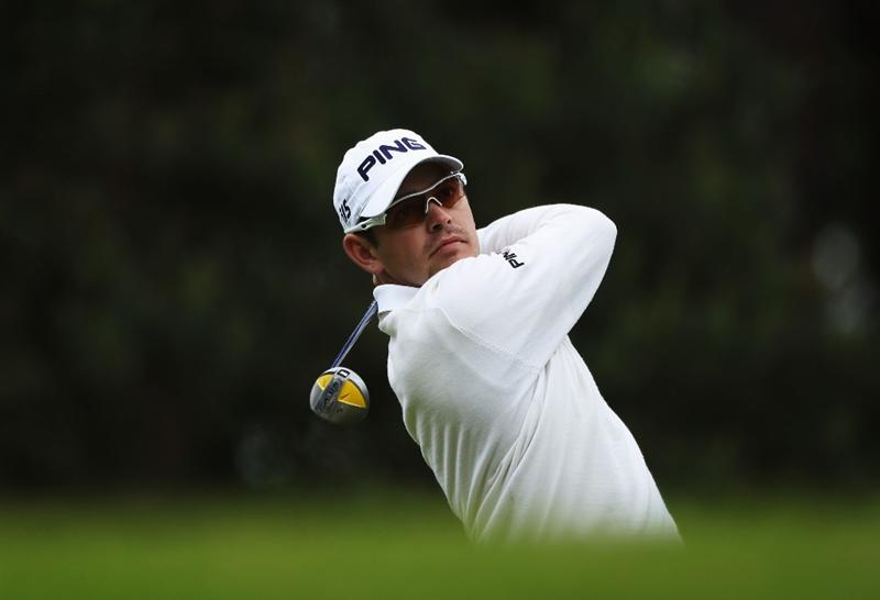VIRGINIA WATER, ENGLAND - MAY 27:  Louis Oosthuizen of South Africa tees off during the second round of the BMW PGA Championship at the Wentworth Club on May 27, 2011 in Virginia Water, England.  (Photo by Warren Little/Getty Images)