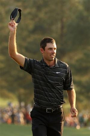 AUGUSTA, GA - APRIL 10:  Charl Schwartzel of South Africa waves to the gallery on the 18th green during the final round of the 2011 Masters Tournament on April 10, 2011 in Augusta, Georgia.  (Photo by Andrew Redington/Getty Images)