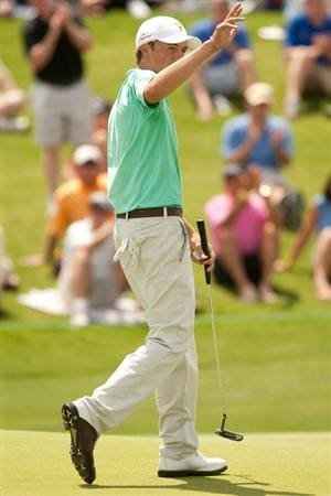 IRVING, TX - MAY 21: Jordan Spieth waves to the crowd at the 18th hole following the second round of the HP Byron Nelson Championship at TPC Four Seasons Resort Las Colinas on May 21, 2010 in Irving, Texas. (Photo by Darren Carroll/Getty Images)