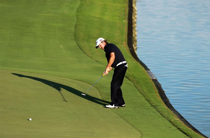 PONTE VEDRA BEACH, FL - MAY 15:  Graeme McDowell of Northern Ireland putts on the 18th hole during the final round of THE PLAYERS Championship held at THE PLAYERS Stadium course at TPC Sawgrass on May 15, 2011 in Ponte Vedra Beach, Florida.  (Photo by Scott Halleran/Getty Images)
