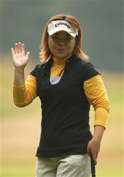 SUNNINGDALE, UNITED KINGDOM - JULY 31:  Yuri Fudoh of Japan acknowledges the crowd on the second green during the first round of the 2008 Ricoh Women's British Open held on the Old Course at Sunningdale Golf Club on July 31, 2008 in Sunningdale, England.  (Photo by Warren Little/Getty Images)