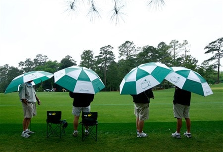 AUGUSTA, GA - APRIL 12:  Patrons wait under umbrellas during the third round of the 2008 Masters Tournament at Augusta National Golf Club on April 12, 2008 in Augusta, Georgia.  (Photo by Jamie Squire/Getty Images)