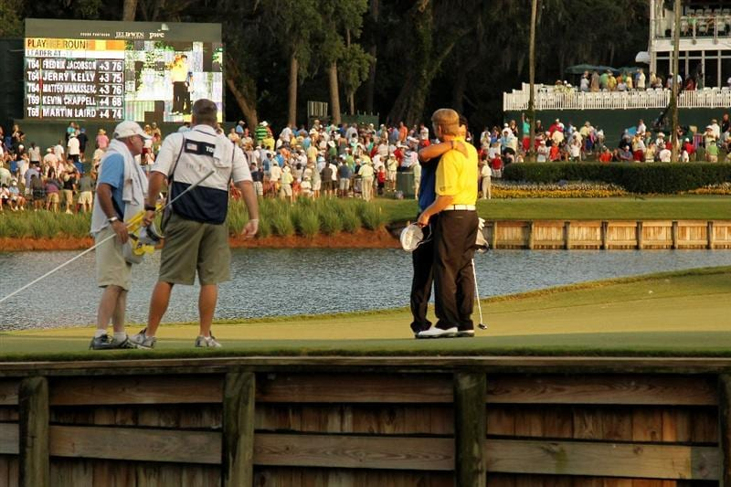 PONTE VEDRA BEACH, FL - MAY 15:   K.J. Choi of South Korea hugs David Toms after defeating him on the first playoff hole to win THE PLAYERS Championship held at THE PLAYERS Stadium course at TPC Sawgrass on May 15, 2011 in Ponte Vedra Beach, Florida.  (Photo by Mike Ehrmann/Getty Images)