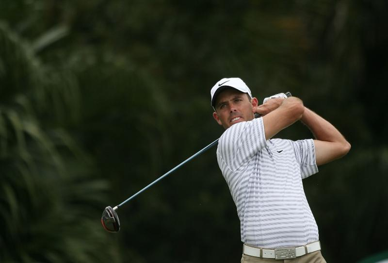 DORAL, FL - MARCH 11:  Charl Schwartzel of South Africa tees off on the 12th tee box during round one of the 2010 WGC-CA Championship at the TPC Blue Monster at Doral on March 11, 2010 in Doral, Florida.  (Photo by Marc Serota/Getty Images)