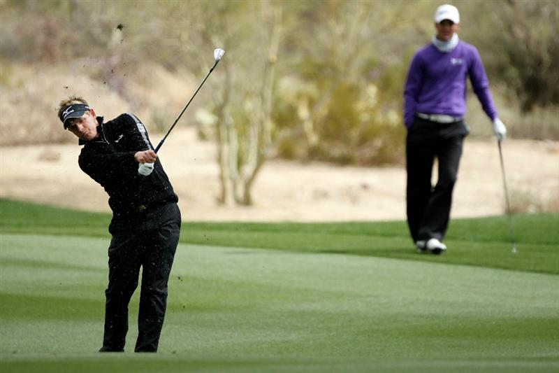 MARANA, AZ - FEBRUARY 27:  Luke Donald of England (L) hits his third shot on the second hole as Martin Kaymer of Germany (R) looks on during the final round of the Accenture Match Play Championship at the Ritz-Carlton Golf Club on February 27, 2011 in Marana, Arizona.  (Photo by Andy Lyons/Getty Images)