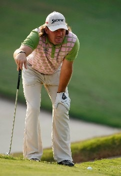 SHENZHEN, CHINA - NOVEMBER 22:  Alex Cejka of Germany lines up a putt on the 15th hole during the first round of the Omega Mission Hills World Cup at the Mission Hills Golf Resort on November 22, 2007 in Shenzhen, China.  (Photo by Stuart Franklin/Getty Images)
