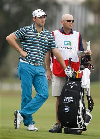 DORAL, FL - MARCH 11:  Oliver Wilson of England waits with his caddie during the first round of the 2010 WGC-CA Championship at the TPC Blue Monster at Doral on March 11, 2010 in Doral, Florida.  (Photo by Scott Halleran/Getty Images)