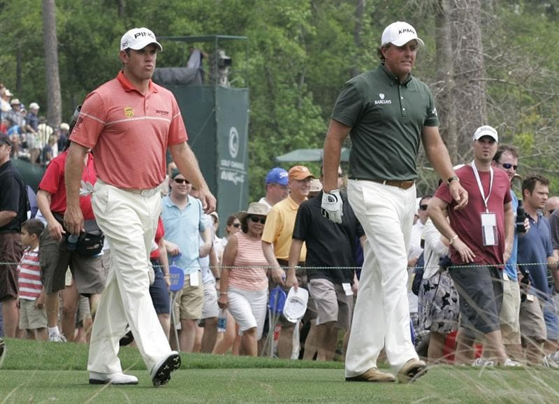 HUMBLE, TX - APRIL 02: (L - R) Lee Westwood of England and Phil Mickelson walk off the 13th tee box during the third round of the Shell Houston Open at Redstone Golf Club on April 2, 2011 in Humble, Texas.  (Photo by Michael Cohen/Getty Images)