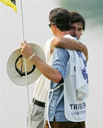 CROMWELL, CT - JUNE 27:  Bubba Watson embraces  his caddie, Ted Scott, after winning a two-hole playoff after the final round of the Travelers Championship held at TPC River Highlands on June 27, 2010 in Cromwell, Connecticut.  (Photo by Michael Cohen/Getty Images)