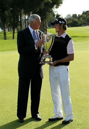 PACIFIC PALISADES, CA - FEBRUARY 20:  Tournament execuctive director and NBA legend Jerry West (L) and champion Aaron Baddeley of Australia talk during trophy ceremonies after the final round of the Northern Trust Open at Riviera Country Club on February 20, 2011 in Pacific Palisades, California.  (Photo by Stephen Dunn/Getty Images)