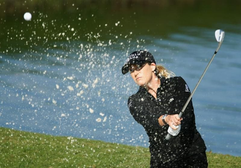 ORLANDO, FL - DECEMBER 05:  Cristie Kerr plays a bunker shot on the third hole during the final round of the LPGA Tour Championship at the Grand Cypress Resort on December 5, 2010 in Orlando, Florida.  (Photo by Scott Halleran/Getty Images)