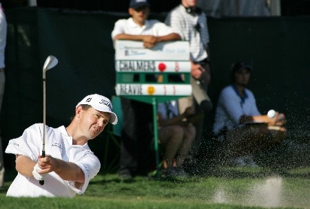 LAKESIDE, CA - NOVEMBER 3:  Greg Chalmers hits out of the sand around the 18th green during the third round of the Nationwide Championship at Barona Creek Golf Course November 3, 2007 in Lakeside, California.  (Photo by Kent Horner/Getty Images)