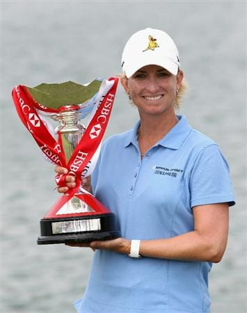 SINGAPORE - FEBRUARY 27:  Karrie Webb of Australia poses with the trophy after winning the HSBC Women's Champions at the Tanah Merah Country Club on February 27, 2011 in Singapore.  (Photo by Andrew Redington/Getty Images)