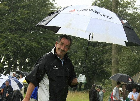 HEXHAM, UNITED KINGDOM - AUGUST 21:  Sam Torrance of Scotland smiles as he walks from the first tee in the rain during the first round of the De Vere Collection PGA Seniors Championship played over the Hunting Course, Slaley Hall on August 21, 2008 in Hexham, Northumberland, England.  (Photo by Phil Inglis/Getty Images)