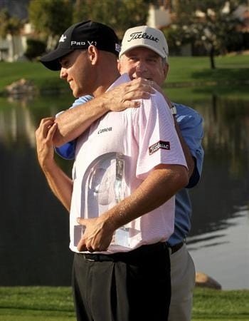 LA QUINTA, CA - JANUARY 25:  Bill Haas (L) is congratulated by father and former tournament champion Jay Haas on the 18th green after Bill's victory at the Palmer Private course at PGA West during the final round of the Bob Hope Classic on January 25, 2010 in La Quinta, California.  (Photo by Stephen Dunn/Getty Images)