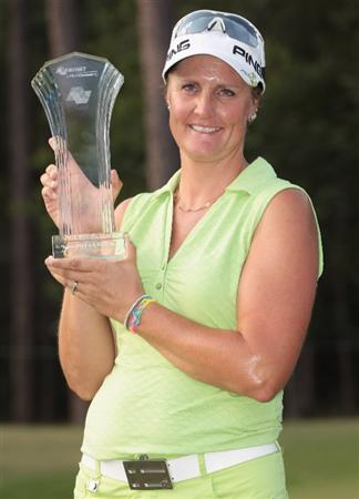 MOBILE, AL - MAY 01:  Maria Hjorth of Sweden poses with the trophy on the 18th green after her two-stroke victory at the Avnet LPGA Classic at the Crossings Course at the Robert Trent Jones Trail at Magnolia Grove on May 1, 2011 in Mobile, Alabama.  (Photo by Scott Halleran/Getty Images)