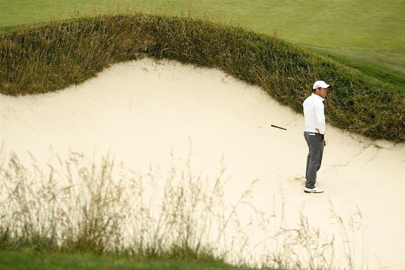 PEBBLE BEACH, CA - JUNE 18:  Paul Casey of England waits in a bunker on the ninth hole during the second round of the 110th U.S. Open at Pebble Beach Golf Links on June 18, 2010 in Pebble Beach, California.  (Photo by Ross Kinnaird/Getty Images)