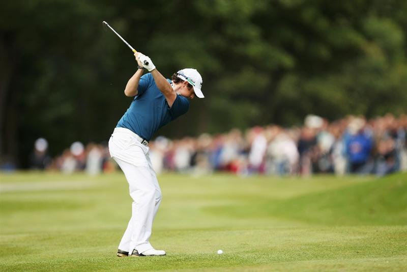 VIRGINIA WATER, ENGLAND - MAY 27:  Rory McIlroy of Northern Ireland hits his 2nd shot on the 16th hole during the second round of the BMW PGA Championship at the Wentworth Club on May 27, 2011 in Virginia Water, England.  (Photo by Ian Walton/Getty Images)
