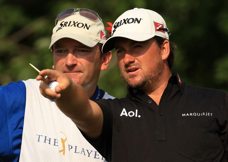 PONTE VEDRA BEACH, FL - MAY 13:  Graeme McDowell of Northern Ireland (R) and caddie Ken Comboy (L) talk on the fifth tee box during the second round of THE PLAYERS Championship held at THE PLAYERS Stadium course at TPC Sawgrass on May 13, 2011 in Ponte Vedra Beach, Florida.  (Photo by Streeter Lecka/Getty Images)