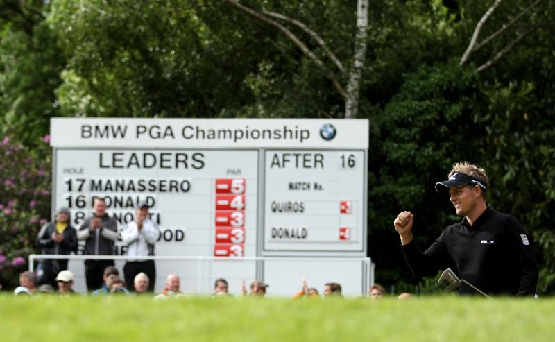 VIRGINIA WATER, ENGLAND - MAY 28:  Luke Donald of England celebrates holing a putt on the 17th green during the third round of the BMW PGA Championship at the Wentworth Club on May 28, 2011 in Virginia Water, England.  (Photo by Warren Little/Getty Images)