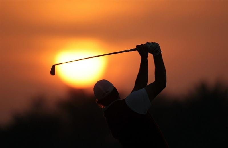 ABU DHABI, UNITED ARAB EMIRATES - JANUARY 19:  Phil Mickelson of the USA warming up on the driving range as the sun rises before the pro-am as a preview for the 2011 Abu Dhabi HSBC Golf Championship to be held at the Abu Dhabi Golf Club on January 19, 2011 in Abu Dhabi, United Arab Emirates.  (Photo by David Cannon/Getty Images)