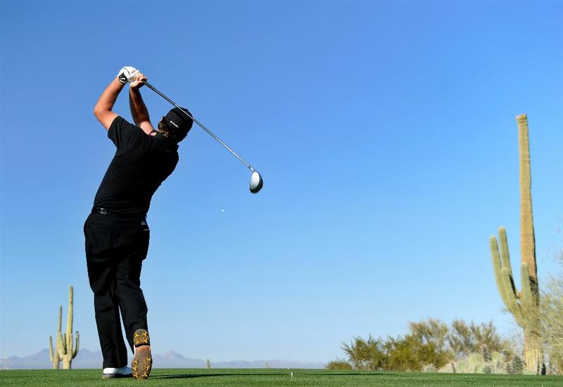 MARANA, AZ - FEBRUARY 24:  Graeme McDowell of Northern Ireland hits his tee shot on the second hole during the second round of the Accenture Match Play Championship at the Ritz-Carlton Golf Club on February 24, 2011 in Marana, Arizona.  (Photo by Stuart Franklin/Getty Images)