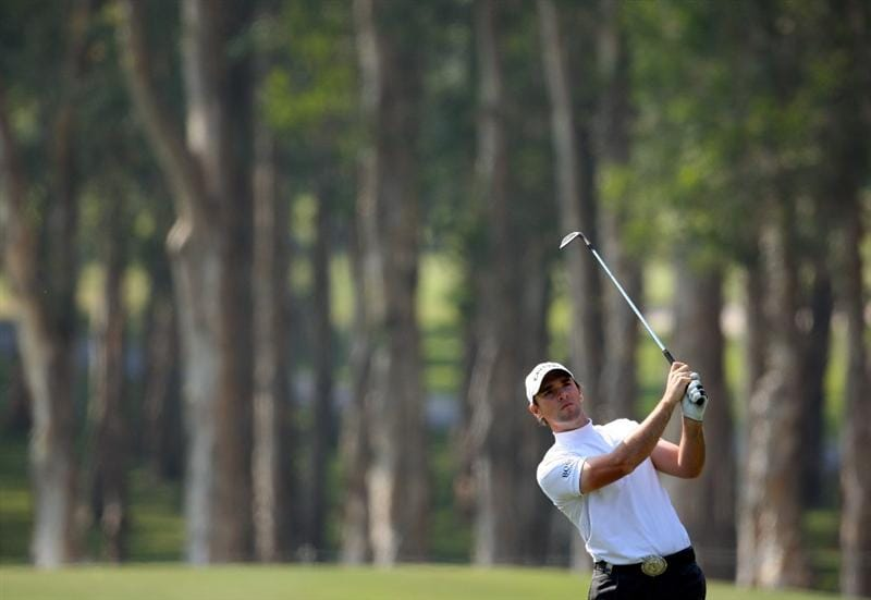 HONG KONG, CHINA - NOVEMBER 21:  Oliver Wilson of England plays his approach shot on the sixth hole during the second round of the UBS Hong Kong Open at the Hong Kong Golf Club on November 21, 2008 in Fanling, Hong Kong.  (Photo by Stuart Franklin/Getty Images)