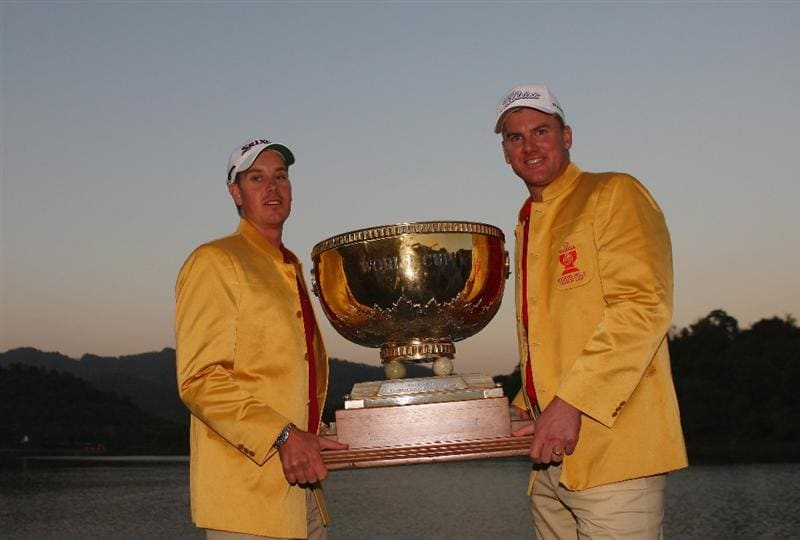 SHENZHEN, CHINA - NOVEMBER 30:  Henrik Stenson and Robert Karlsson of Sweden celebrate with the trophy after winning the final round of the Omega Mission Hills World Cup at the Mission Hills Resort on November 30, 2008 in Shenzhen, China.  (Photo by Stuart Franklin/Getty Images)