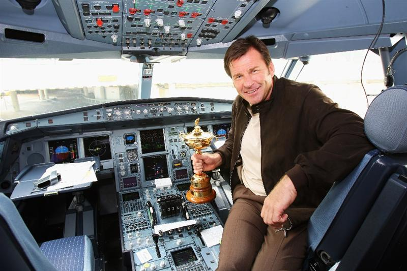 LONDON - SEPTEMBER 15:  Ryder Cup captain Nick Faldo poses in the cockpit with the Trophy at Heathrow airport before heading to the United States with Team Europe for the Ryder Cup on September 15, 2008 in London, England. The 2008 Ryder Cup will be held at Valhalla Golf Club in Louisville, Kentucky over the weekend of 19-21 September.  (Photo by Andrew Redington/Getty Images)