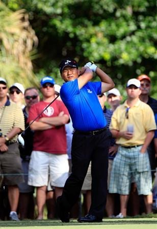 PONTE VEDRA BEACH, FL - MAY 15:  K.J. Choi of South Korea hits his tee shot on the 15th hole during the final round of THE PLAYERS Championship held at THE PLAYERS Stadium course at TPC Sawgrass on May 15, 2011 in Ponte Vedra Beach, Florida.  (Photo by Sam Greenwood/Getty Images)