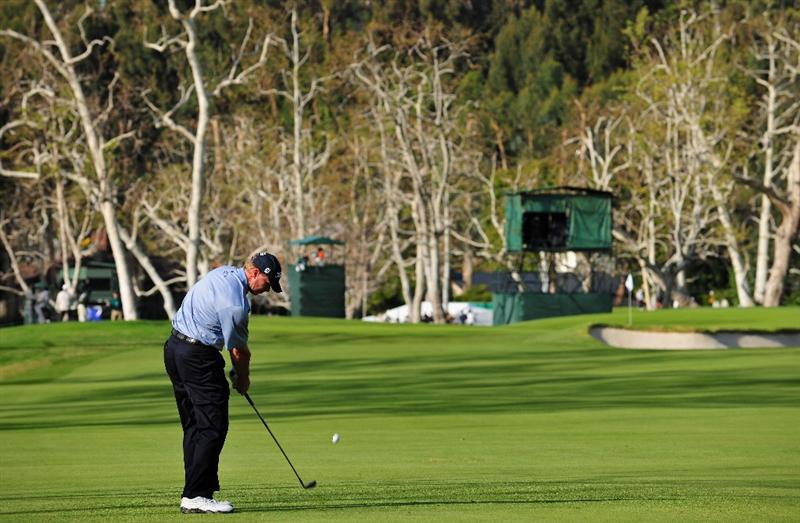 PACIFIC PALISADES, CA - FEBRUARY 20:  Steve Stricker of USA plays his approach shot on the 15th hole during the second round of the Northern Trust Open at the Riviera Country Club February 20, 2009 in Pacific Palisades, California.  (Photo by Stuart Franklin/Getty Images)