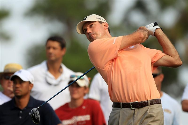 PONTE VEDRA BEACH, FL - MAY 12:  Matt Kuchar hits his tee shot on the fourth hole during the first round of THE PLAYERS Championship held at THE PLAYERS Stadium course at TPC Sawgrass on May 12, 2011 in Ponte Vedra Beach, Florida.  (Photo by Streeter Lecka/Getty Images)