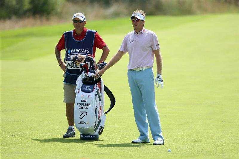 LUSS, SCOTLAND - JULY 11:  Ian Poulter of England lines up a shot with Caddy Terry Mundy during the Third Round of The Barclays Scottish Open at Loch Lomond Golf Club on July 11, 2009 in Luss, Scotland.  (Photo by Andrew Redington/Getty Images)