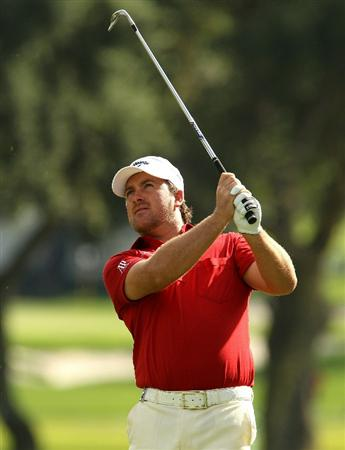 SOTOGRANDE, SPAIN - OCTOBER 29:  Graeme McDowell of Northern Ireland plays into the 1st green during the second round of the Andalucia Valderrama Masters at Club de Golf Valderrama on October 29, 2010 in Sotogrande, Spain.  (Photo by Richard Heathcote/Getty Images)
