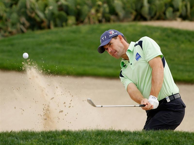 ABU DHABI, UNITED ARAB EMIRATES - JANUARY 18: Padraig Harrington of Ireland a bunker shot during a practice round prior to the start of the 2011 Abu Dhabi HSBC Golf Championship  at the Abu Dhabi Golf Club on January 18, 2011 in Abu Dhabi, United Arab Emirates.  (Photo by Scott Halleran/Getty Images)