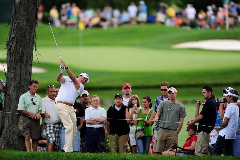 AKRON, OH - AUGUST 05:  Phil Mickelson of USA plays his approach shot during a practice round of the World Golf Championship Bridgestone Invitational on August 5, 2009 at Firestone Country Club in Akron, Ohio.  (Photo by Stuart Franklin/Getty Images)