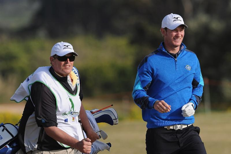 RAGUSA, ITALY - MARCH 18:  Chris Wood of England and caddie Matt Harbour during the second round of the Sicilian Open at the Donnafugata golf resort and spa on March 18, 2011 in Ragusa, Italy.  (Photo by Stuart Franklin/Getty Images)