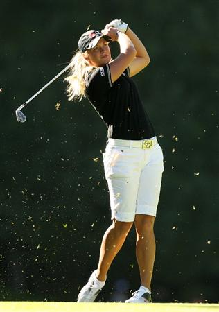 GUADALAJARA, MX - NOVEMBER 13: Suzann Pettersen of Norway hits her second shot on the 15th hole during the first round of the Lorena Ochoa Invitational at Guadalajara Country Club on November 13, 2008 in Guadalajara, Mexico. (Photo by Hunter Martin/Getty Images)