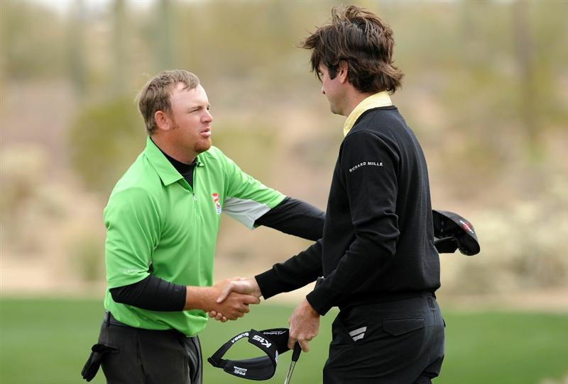 MARANA, AZ - FEBRUARY 26:  Bubba Watson shakes hands with J.B. Holmes on the first playoff hole during the quarterfinal round of the Accenture Match Play Championship at the Ritz-Carlton Golf Club on February 26, 2011 in Marana, Arizona.  (Photo by Stuart Franklin/Getty Images)