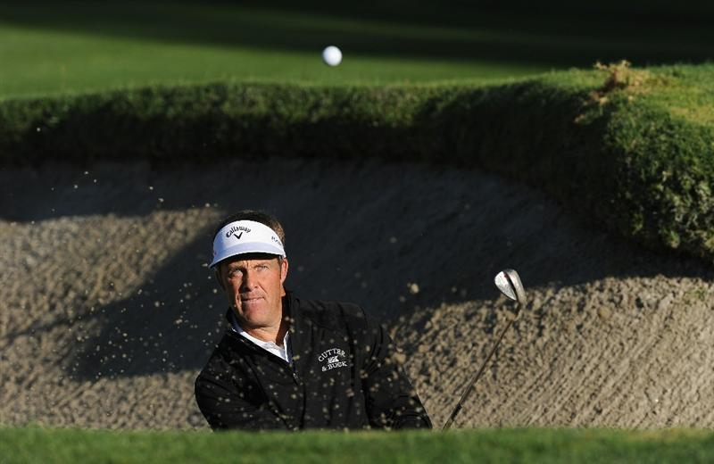 PACIFIC PALISADES, CA - FEBRUARY 17:  Stuart Appleby of Australia plays his bunker shot on the first hole during the first round of the Northern Trust Open at Riviera Country Club on February 17, 2011 in Pacific Palisades, California.  (Photo by Stuart Franklin/Getty Images)