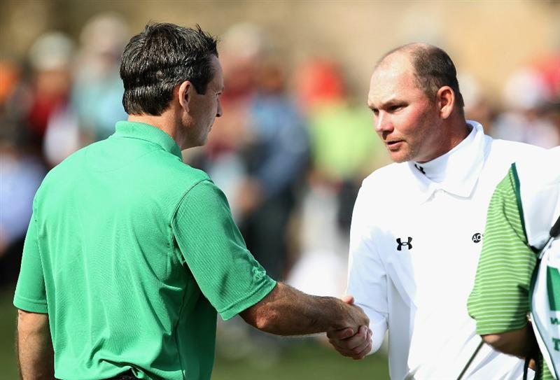 SCOTTSDALE, AZ - FEBRUARY 06:  Mark Wilson shakes hands with Tommy Gainey on the ninth hole after finishing the third round of the Waste Management Phoenix Open at TPC Scottsdale on February 6, 2011 in Scottsdale, Arizona.  (Photo by Christian Petersen/Getty Images)
