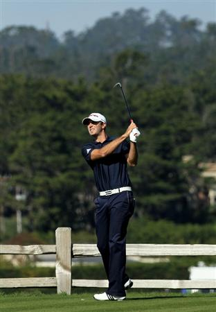 PEBBLE BEACH, CA - FEBRUARY 14:  Dustin Johnson hits his tee shot on the seventh hole during the final round of the AT&T Pebble Beach National Pro-Am at Pebble Beach Golf Links on February 14, 2010 in Pebble Beach, California.  (Photo by Stephen Dunn/Getty Images)