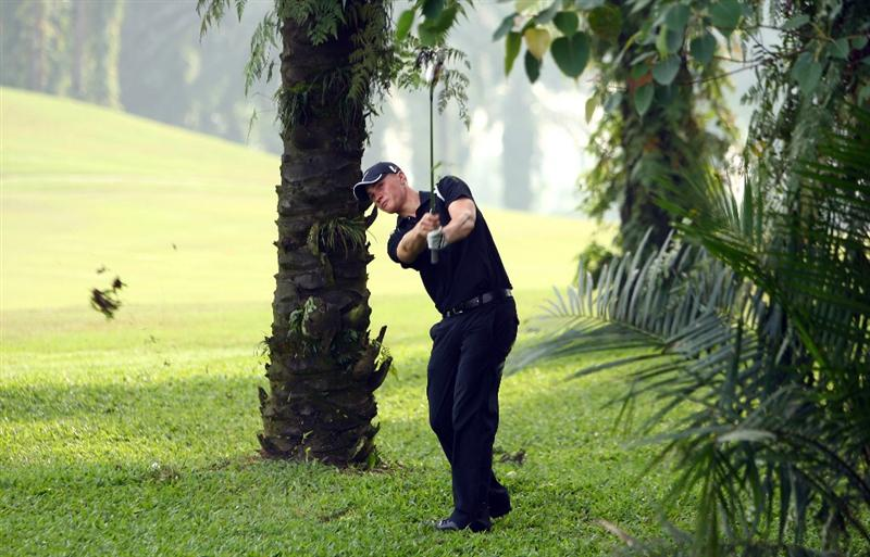KUALA LUMPUR, MALAYSIA - FEBRUARY 12:  Oliver Fisher of England plays from the rough on the 16th hole during the first round of the 2009 Maybank Malaysian Open at Saujana Golf and Country Club on February 12, 2009 in Kuala Lumpur, Malaysia.  (Photo by Ian Walton/Getty Images)