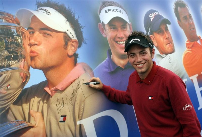 ST. ANDREWS, UNITED KINGDOM - OCTOBER 01: Defending champion Nick Dougherty of England signs his photo in the media centre during the final practice round of The Alfred Dunhill Links Championship at The Old Course on October 1, 2008 in St.Andrews, Scotland.  (Photo by Warren Little/Getty Images)